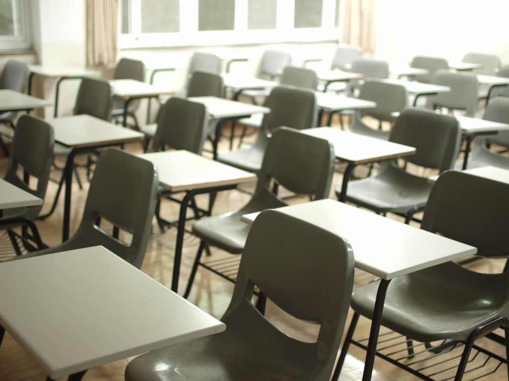 Photo shows desks and tables set out for an exam